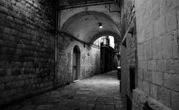 Grayscale Photo of Brick Walled Alley Royalty Free Stock Photo