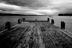 Grayscale Photo of Bridge on Body of Water Stock Images