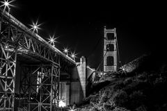 Grayscale Photo of Bridge during Night Stock Image