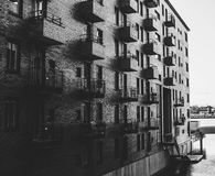Grayscale Photo of Building Beside Body of Water royalty free stock photo