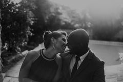 Grayscale Photo of Couple at Garden Near Pool Royalty Free Stock Image