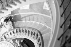 Grayscale Photo of Couple Standing on Stairs royalty free stock images