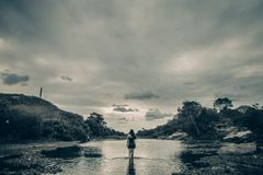 Grayscale Photo of Female on Body of Water Stock Photos