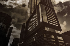 Grayscale Photo of Glass City Building Under Clear Sky and White Clouds Royalty Free Stock Photo