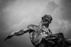 Grayscale Photo of Gray Man Statue Stock Photo