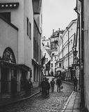 Grayscale Photo of Group of People Walking in Alley Royalty Free Stock Photos