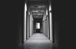 Grayscale Photo of Hallway Royalty Free Stock Image