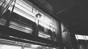 Grayscale Photo of Hanged Ceiling Lamp Inside the Building stock photos