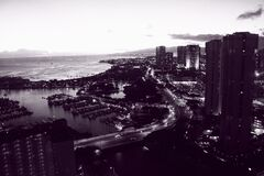 Grayscale Photo of High Rise Building Near Body of Water Royalty Free Stock Image