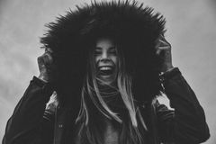 Grayscale Photo of Laughing Woman Holding Her Hat Stock Images