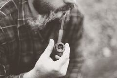Grayscale Photo of Man Holding Tobacco Pipe Stock Photos