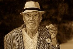 Grayscale Photo of a Man in Houndstooth Print Suit Jacket Wearing a Hat Royalty Free Stock Photos