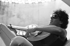 Grayscale Photo of Man Playing Guitar Stock Images