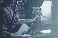 Grayscale Photo of Man Playing Guitar Stock Image