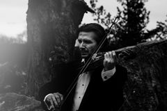 Grayscale Photo of Man Playing Violin Stock Images