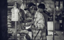 Grayscale Photo of a Man Selling Sandwiches on the Streets royalty free stock photo