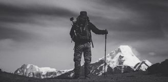 Grayscale Photo of Man Standing on Ground Royalty Free Stock Images