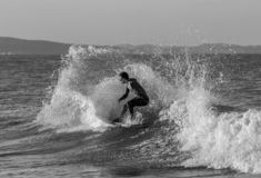 Grayscale Photo of Man Surfing stock photography