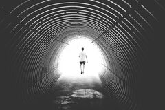 Grayscale Photo of Man Walking in Hole Royalty Free Stock Images