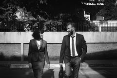 Grayscale Photo of Man and Woman in Formal Suits Royalty Free Stock Photography