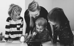 Grayscale Photo of Mother and Three Children Playing royalty free stock photos