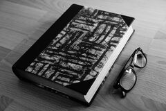 Free Grayscale Photo Of Eyeglasses Near Thickbound Book Stock Image - 82930221