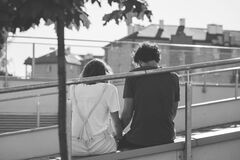 Free Grayscale Photo Of Man And Woman Sitting On Inclined Road Stock Image - 82930381