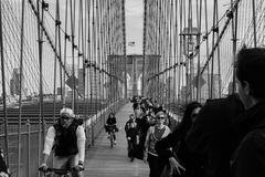 Grayscale Photo of People Walking on a Bridge during Daytime Stock Image