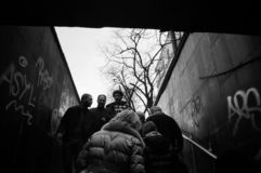 Grayscale Photo of People Walking Between Concrete Wall royalty free stock image