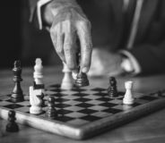 Grayscale Photo of Person Holding Chess Piece royalty free stock photos