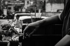 Grayscale Photo of Person Resting His Arm stock image