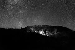 Grayscale Photo of Person Standing Under Starry Night Royalty Free Stock Photos