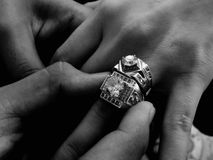 Grayscale Photo of Person Wearing Two Diamond-encrusted Rings Stock Image