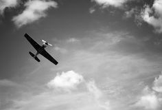 Grayscale Photo of a Plane Soaring on the Sky Royalty Free Stock Images