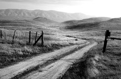 Grayscale Photo of Road and Mountain at Daytime Royalty Free Stock Photos
