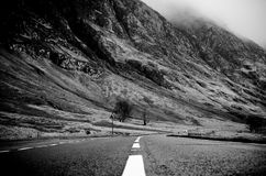Grayscale Photo of Road Thru Mountain Royalty Free Stock Photos