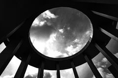 Grayscale Photo of a Round Building With Hole royalty free stock image