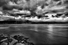 Grayscale Photo of Sea during Cloudy Sky at Daytime Royalty Free Stock Photos