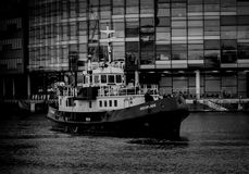 Grayscale Photo of Ship Near Building royalty free stock photo