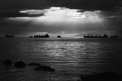 Grayscale Photo of Ships on Water Royalty Free Stock Images