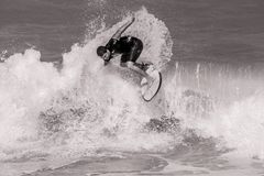 Grayscale Photo of Surfer on Ocean Waves Royalty Free Stock Photography