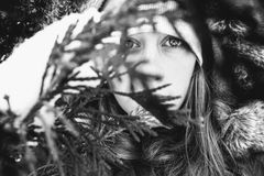 Grayscale Photo Of Woman Behind Leaves royalty free stock photo