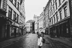 Grayscale Photo of a Woman Between Buildings Photo Royalty Free Stock Photo
