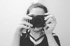 Grayscale Photo of Woman Holding Dslr Camera Stock Images