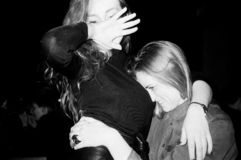 Grayscale Photo of Woman Hugging Woman in Black Long-sleeved Shirt royalty free stock photography