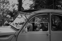 Grayscale Photo Of Woman Inside Classic Car stock image