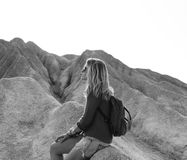Grayscale Photo of Woman Sitting on Rock royalty free stock photos