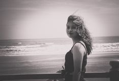 Grayscale Photo of Woman Wearing Tank Top Standing Near Seashore Royalty Free Stock Photo