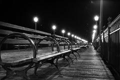 Grayscale Photo of Wooden Bench Beside Lamp Post Stock Photos