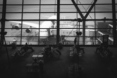 Grayscale Photography of Airport With People Sitting on Benches Stock Photography